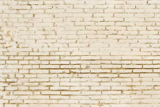 Alte beige backsteinmauerhintergrundbeschaffenheit Premium Fotos