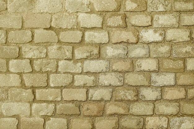 Alte beige steinpflasterungshintergrundbeschaffenheit Premium Fotos