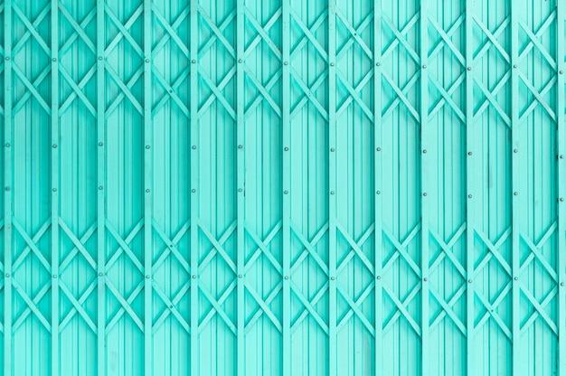 Alte grüne stahltür stahltür mit rostigem metall, retro- weinlese des schmutzes der stahltür für design Premium Fotos