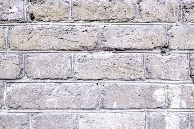 Alte helle backsteinmauer. Premium Fotos