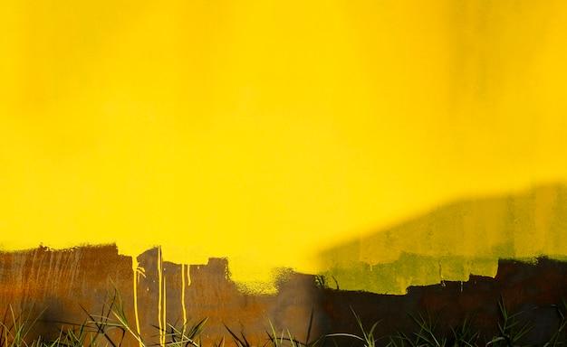 Alte rostige wand mit gelbtönen Kostenlose Fotos