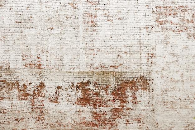 Alte rote backsteinmauer mit weißem farbenhintergrund Premium Fotos