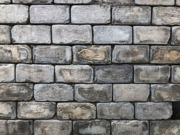 Alter backsteinmauerhintergrund mit dem tageslichtlicht Premium Fotos