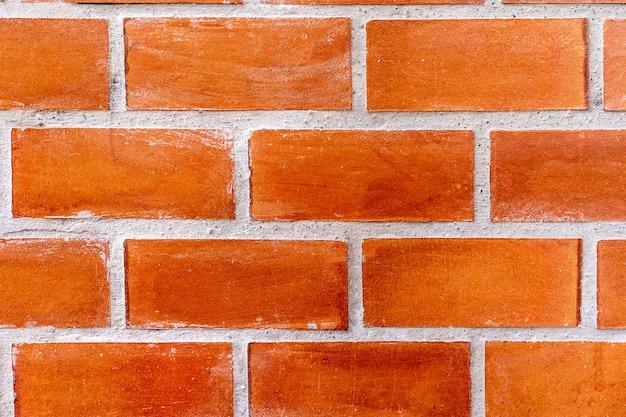 Alter brauner steinziegelsteinwand-musterhintergrund der backsteinmauer Premium Fotos