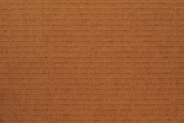 Alter brown-papier-beschaffenheits-hintergrund benutzen uns kraftpapier Premium Fotos