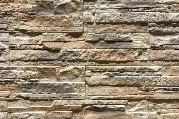 Alter brown-steinbacksteinmauer musterhintergrund. innendekoration und design textur Premium Fotos