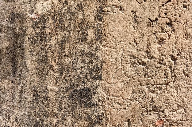Alter grauer zement oder betonmauer. schmutz vergipster strukturierter hintergrund des stucks. Premium Fotos
