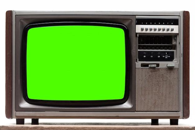 Alter retro- fernsehapparat mit dem grünen bildschirm getrennt auf weiß Premium Fotos