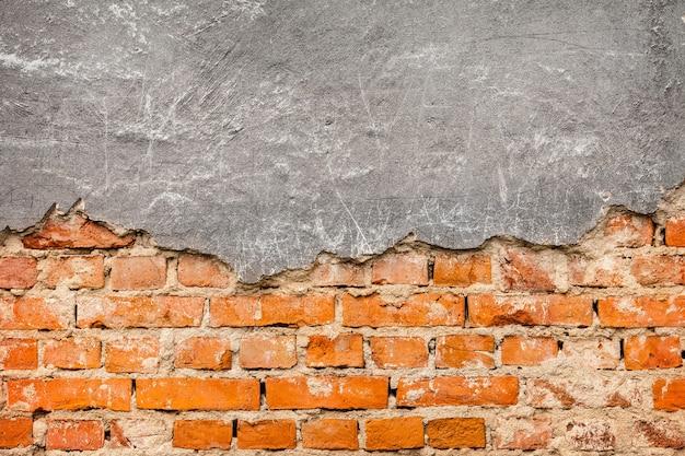 Alter und beschädigter putz auf roter backsteinmauer Kostenlose Fotos