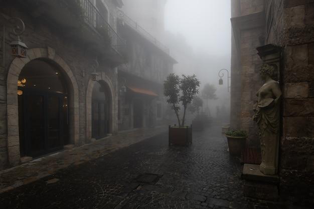 Altes gebäude im dorf im nebel Premium Fotos