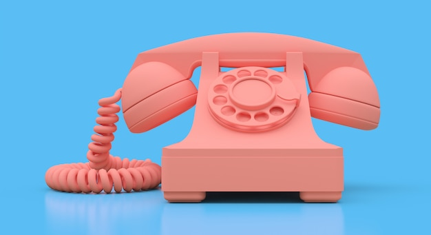 Altes rosafarbenes vorwahlknopftelefon auf einer blauen oberfläche Premium Fotos