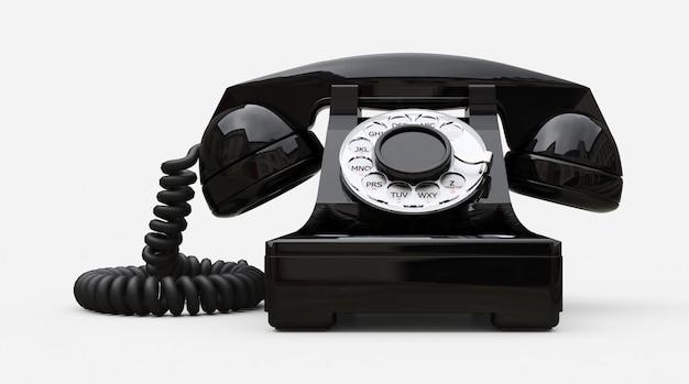 Altes schwarzes vorwahlknopftelefon auf einem weißen hintergrund Premium Fotos