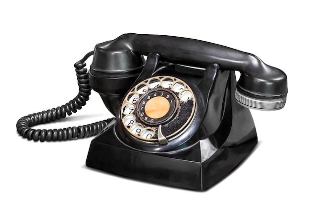 Altes weinlese-telefon lokalisiert auf weiß mit beschneidungspfad Premium Fotos