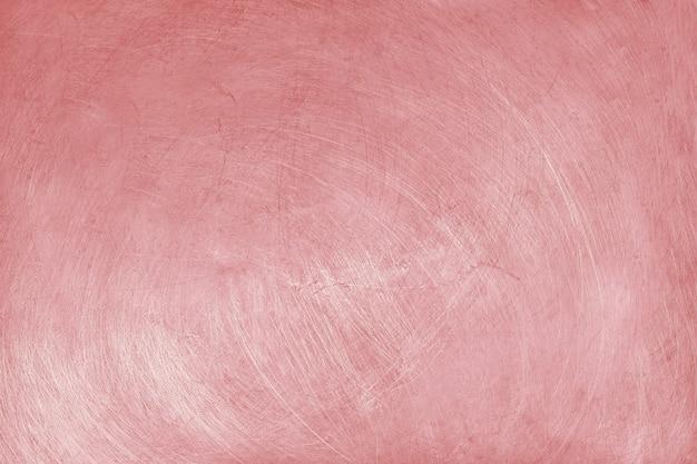 Aluminiumbeschaffenheitshintergrund mit rosengoldfarbe, muster von kratzern auf edelstahl. Premium Fotos