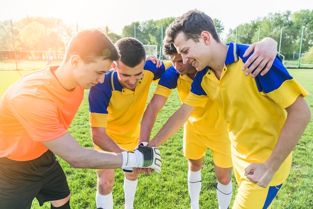 Amateurfußball- und teamwork-konzept Kostenlose Fotos
