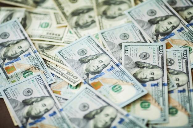 Amerikanische geldhintergrund-beschaffenheitsrechnungen der amerikanischen dollar Premium Fotos