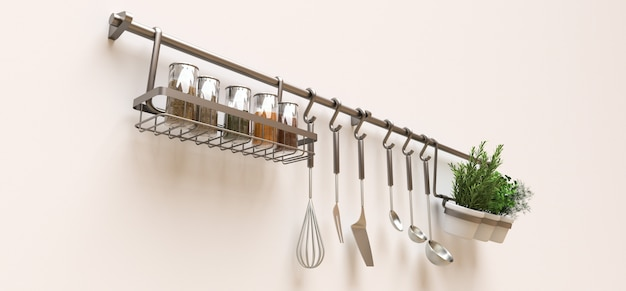 An der wand hängen küchenutensilien, schüttgut und lebende gewürze in töpfen Premium Fotos
