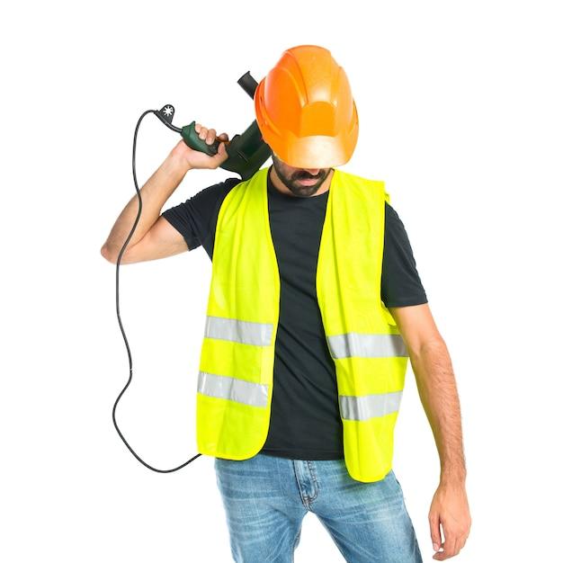 Arbeiter mit bohrer auf weißem hintergrund Kostenlose Fotos
