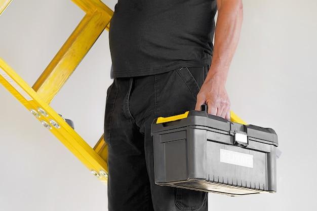 Arbeiter mit holzleiter Premium Fotos