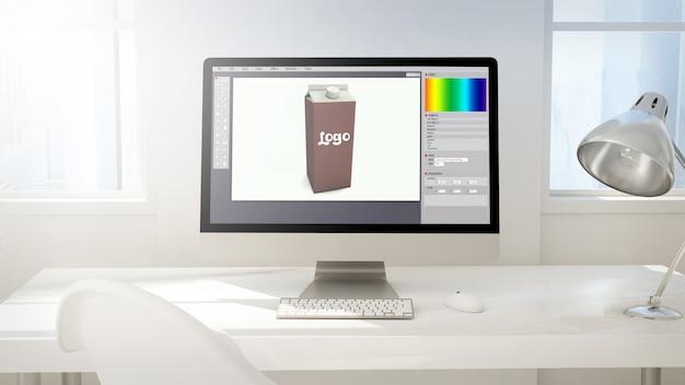 Arbeitsbereich mit computerbildschirm beim verpackungsdesign Premium Fotos