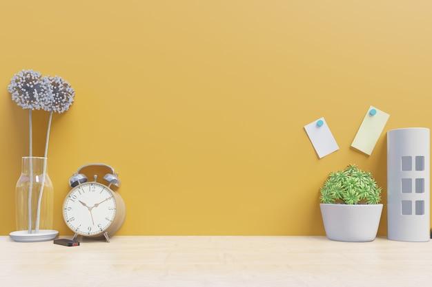 Arbeitstabelle mit dekoration auf gelbem wandhintergrund der schreibtischrückseite Premium Fotos