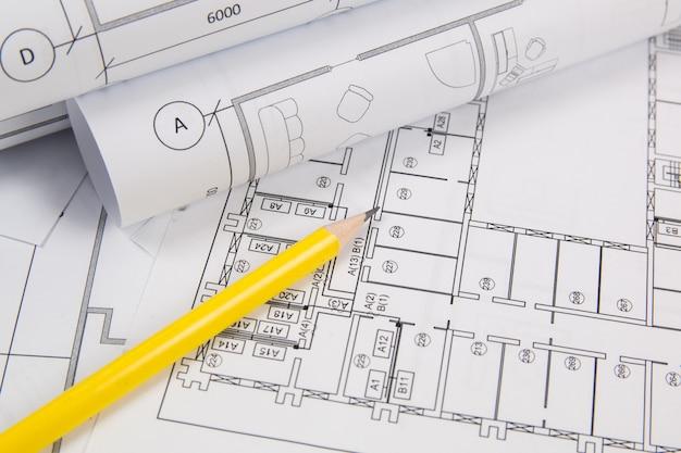 Architekturplan. technische hauszeichnungen, pancil und blaupausen. Premium Fotos