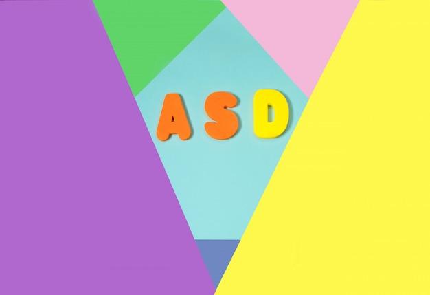 Asd. autismus-spektrum-störung von den farbbuchstaben und vom farbhintergrund Premium Fotos