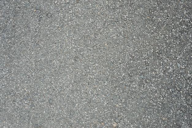 Asphaltstraße mit markierungslinien weißen streifen masern hintergrund. Premium Fotos