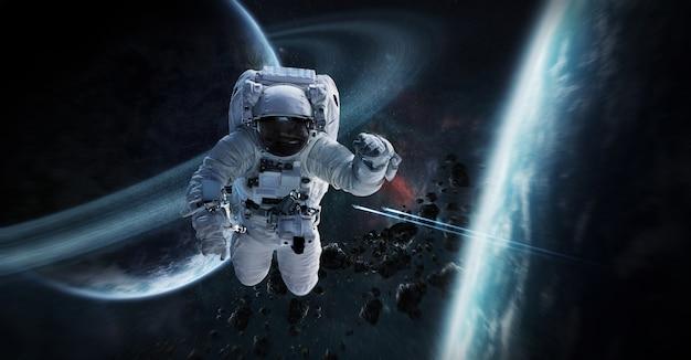 Astronaut, der in wiedergabeelemente des raumes 3d schwimmt Premium Fotos
