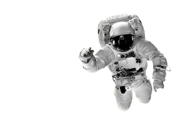 Astronaut fliegt im weltraum über die erde. Premium Fotos