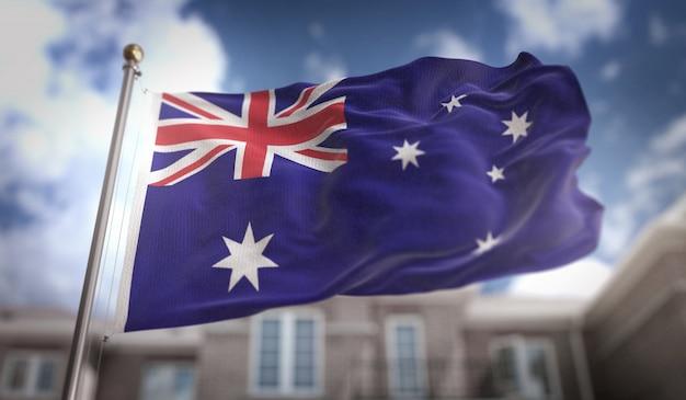 Australien flagge 3d rendering auf blauem himmel gebäude hintergrund Premium Fotos