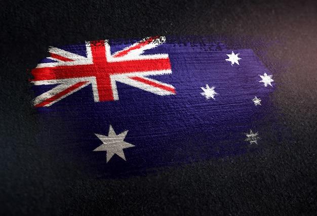 Australien-flagge gemacht von der metallischen bürsten-farbe auf dunkler wand des schmutzes Premium Fotos