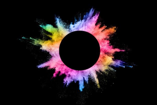 Auszug farbige staubexplosion auf einem schwarzen. Premium Fotos