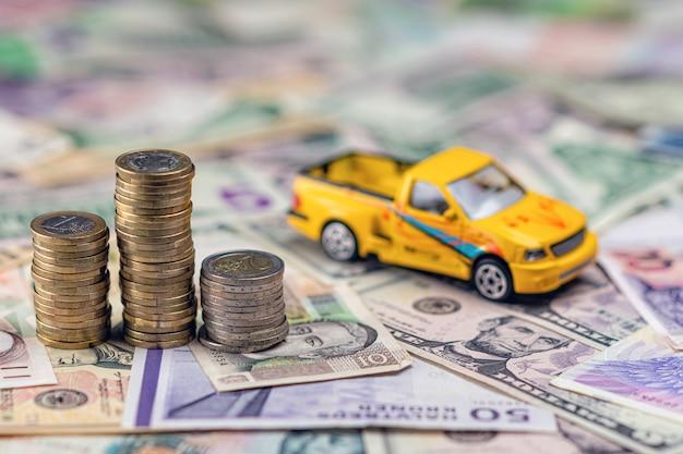 Auto- und geldkonzept Premium Fotos