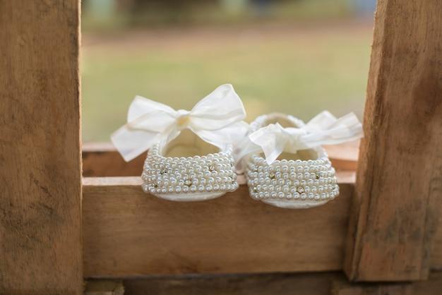 Babyschuhe - taufe Premium Fotos