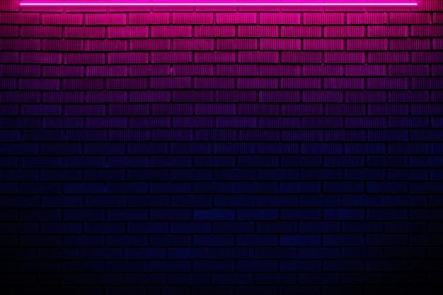 Backsteinmauer im neonlicht. Premium Fotos