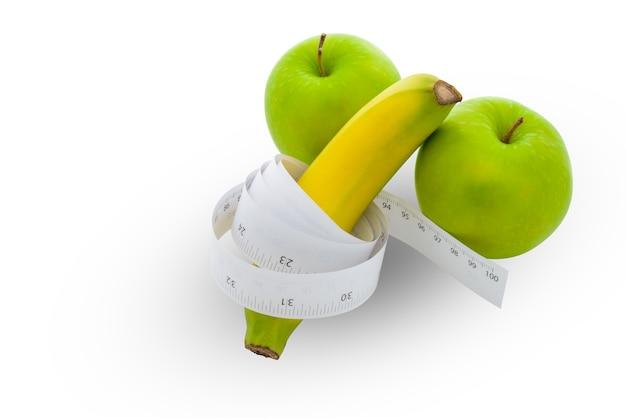 Bananenlänge und männliches genitalkonzept des apfels Premium Fotos