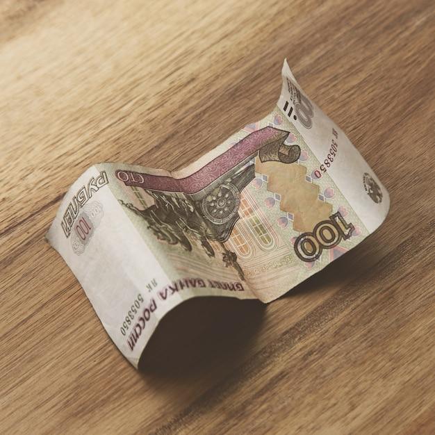 Banknote auf holzoberfläche Kostenlose Fotos
