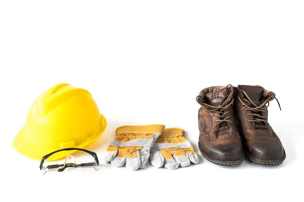 Baustellensicherheit. persönliche schutzausrüstung auf weißem hintergrund Premium Fotos