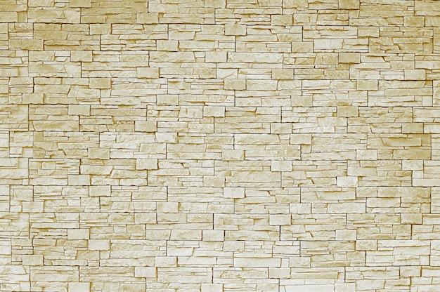 Beige steinmauer hintergrund Premium Fotos