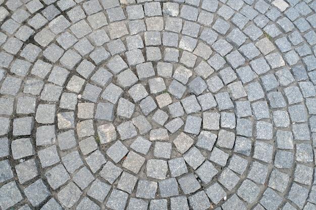 Beschaffenheit der alten pflasterungsnahaufnahme. abstrakter granit-steinhintergrund. Premium Fotos