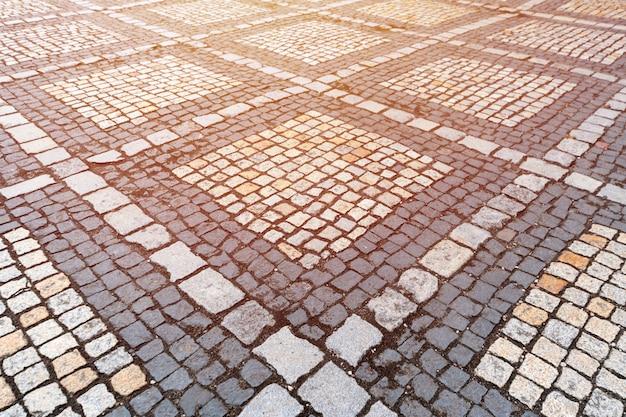 Beschaffenheit des alten deutschen kopfsteins in der stadt im stadtzentrum gelegen. Premium Fotos