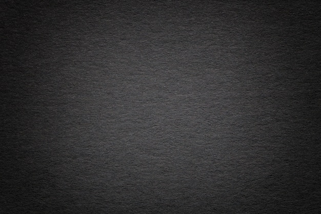 Beschaffenheit des alten papierhintergrundes des dunklen schwarzen, nahaufnahme struktur der dichten pappe Premium Fotos