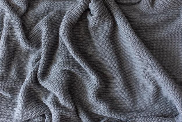 Beschaffenheit des gestrickten woolen gewebes für tapete und einen abstrakten hintergrund Premium Fotos