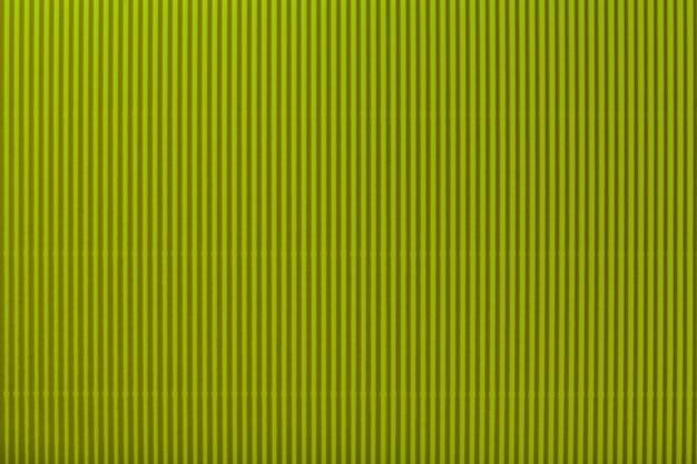Beschaffenheit des gewölbten dunkelgrünen papiers, makro. Premium Fotos