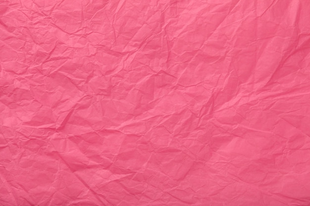 Beschaffenheit des zerknitterten rosa packpapiers Premium Fotos