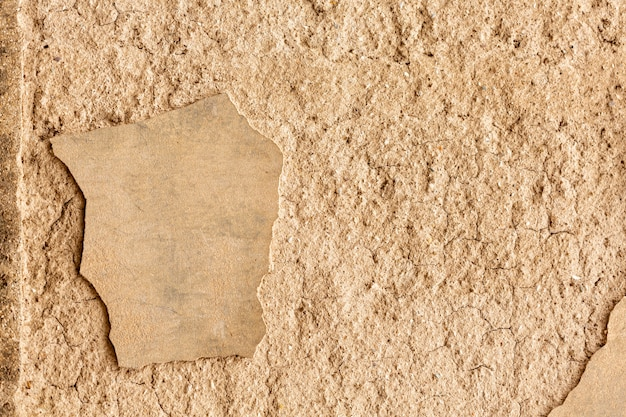 Betonmauer mit rissen und rauer oberfläche Kostenlose Fotos