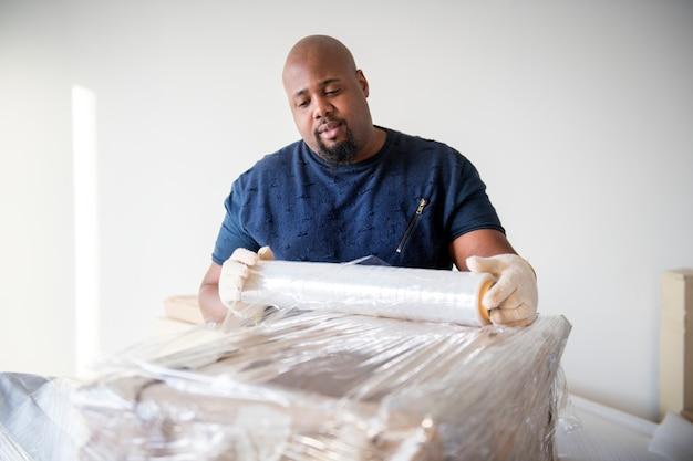 Bewegliche möbel des schwarzen mannes Kostenlose Fotos