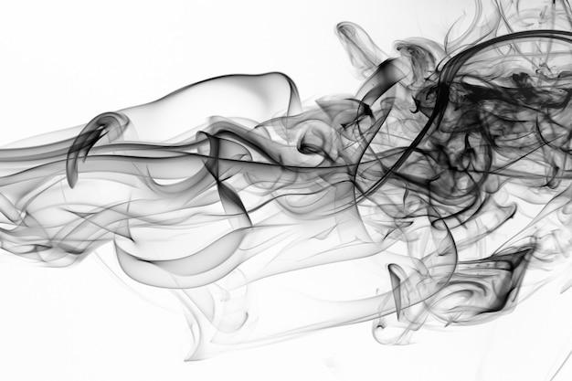 Bewegung des schwarzen rauches auf weißem hintergrund, feuerdesign Premium Fotos