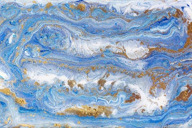 Blau und gold marmorierung. goldene marmorflüssigkeitsbeschaffenheit. Premium Fotos